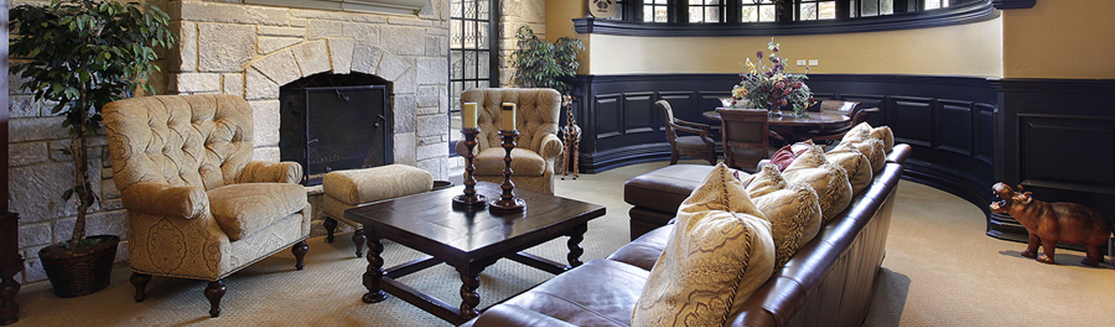 Basement in luxury home with stone fireplace